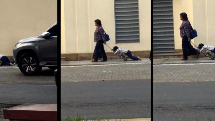 E posibil: Cum a fost filmată o femeie care își ducea copilul la școală (VIDEO)