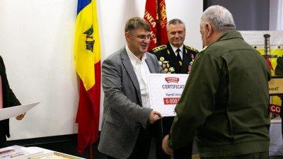 Loteria Moldovei continuă campania de susţinere financiară a veteranilor. 20 de persoane au primit câte 6 mii de lei