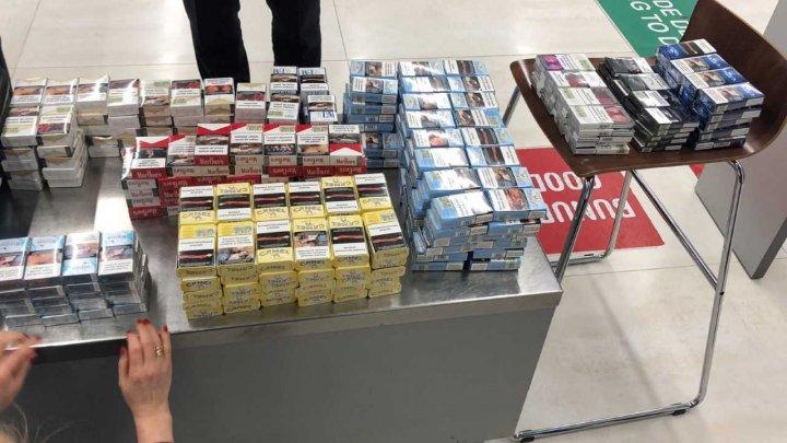 Peste 900 de pachete cu țigări, reținute pe aeroportul din Capitală. Unde urmau să ajungă