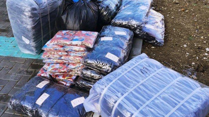 Mărfuri procurate de la piaţa KM7, descoperite de vameşi. Cum au încercat doi şoferi să intre în ţară