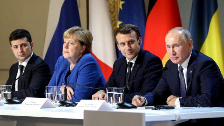 Rusia și Ucraina își retrag trupele din trei zone de conflict