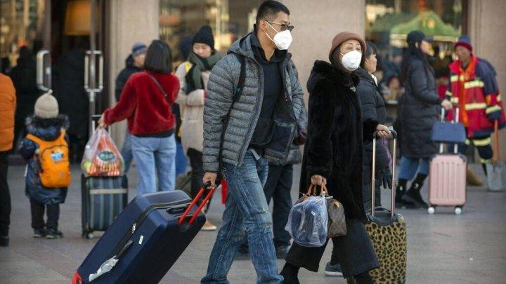 China confirmă transmiterea de la om la om a noului tip de coronavirus şi infecţii în rândul personalului medical