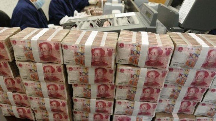 China curăță, la propriu, banii pentru a combate coronavirusul COVID-19