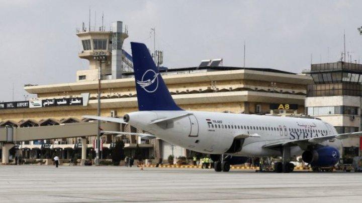 Un avion civil cu miniştri sirieni şi jurnalişti a aterizat miercuri pe aeroportul din Alep