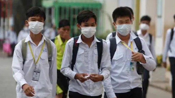 Coronavirus: Elevii din China, obligaţi să poarte măşti în clase