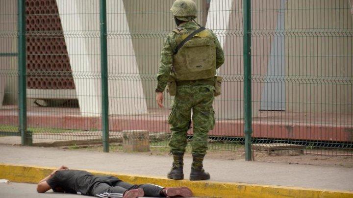 """Atacuri armate în fieful lui """"El Chapo"""". Șapte cadavre, descoperite lângă o camionetă găurită de gloanţe"""
