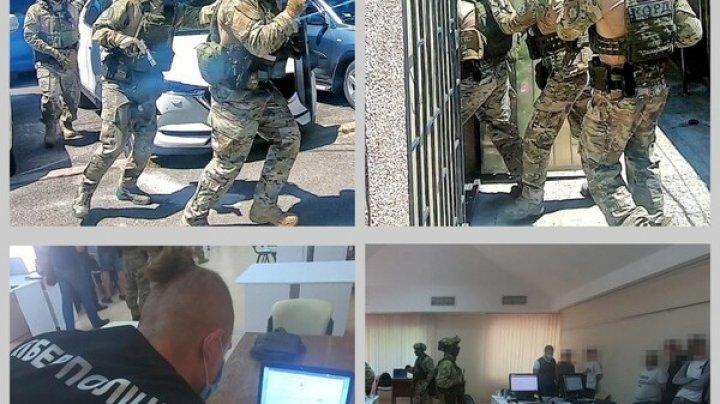 Se prezentau drept angajați ai unei bănci şi obţineau date confidenţiale ale cardurilor bancare. O grupare criminală din Odesa, destructurată
