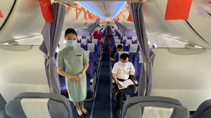 După opt luni, pe aeroportul din Wuhan a ajuns primul zbor internațional. Cum au fost primiți pasagerii