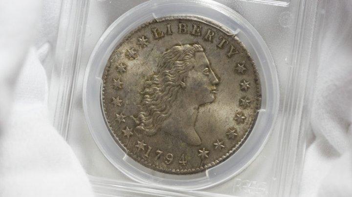 Un dolar din argint din 1794, considerat a fi printre primele monede bătute de Monetăria SUA, va fi scos la licitație
