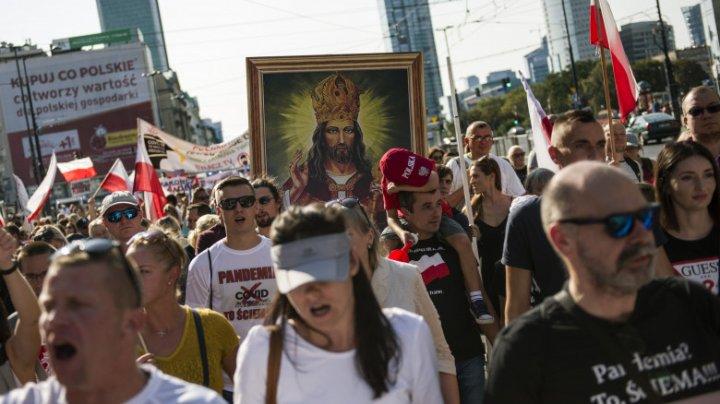 "Proteste ""anti-corona"" în Germania și Polonia. Mesajul transmis de Angela Merkel"
