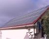 Житель столицы установил на крыше своего дома 46 солнечных батарей и ветрогенератор