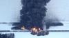 В США поезд с нефтью сошел с рельсов после столкновения