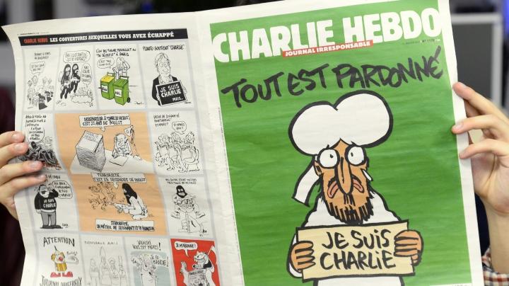Журнал Charlie Hebdo опубликовал карикатуры с погибшим сирийским мальчиком