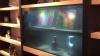 Panasonic разработал телевизор с прозрачным дисплеем (ВИДЕО)