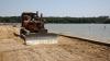 Подготовка к летнему сезону в Вадул-луй-Водэ: рабочие обустраивают базы отдыха