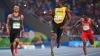 Бегуны Болт и Де Грассе обменялись улыбками на финише полуфинала 200-метрового забега (ВИДЕО)