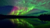 Уникальные кадры: пассажир самолета снял северное сияние в небе над Канадой