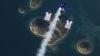 Трое парашютистов совершили прыжок над хорватским островом Галешняк