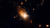Далекая галактика вытолкнула из себя гигантскую черную дыру