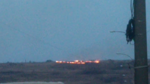 Вблизи Чекан загорелась трава