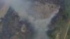 Над пожарищем на улице Петрарией до сих пор клубится дым