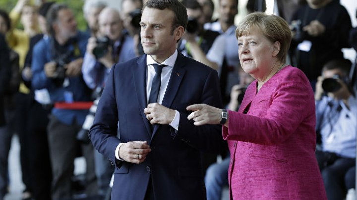 Меркель и Макрон призвали к давлению на Асада ради выполнения резолюции ООН