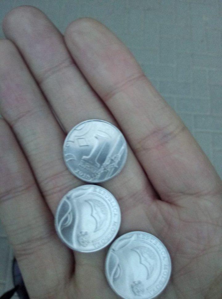 Первые монеты начали поступать в массовое обращение: фото