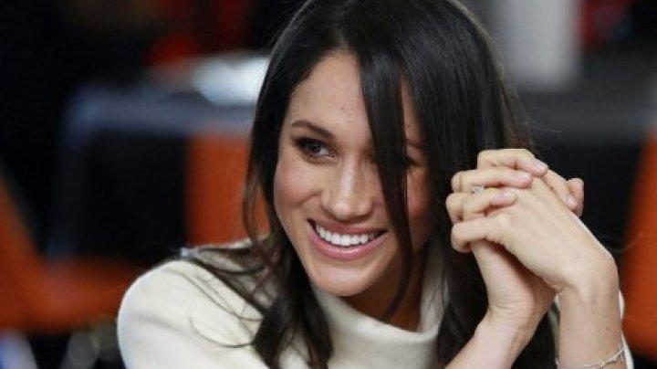 Поклонники вычислили беременность Меган Маркл по волосам