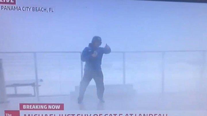 Ведущего едва не убил ураган в прямом эфире (видео)