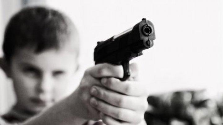 В США ребенок выстрелил в лицо беременной матери