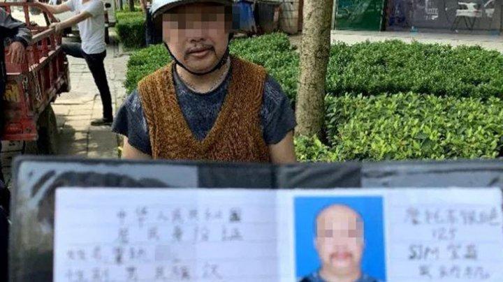 В Китае водителю было лень получать права, и он их нарисовал