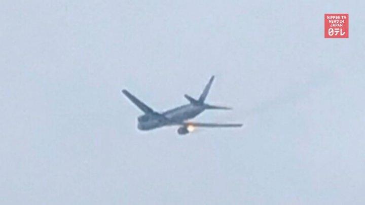 Посадка самолета с загоревшимся двигателем в Японии попала на видео