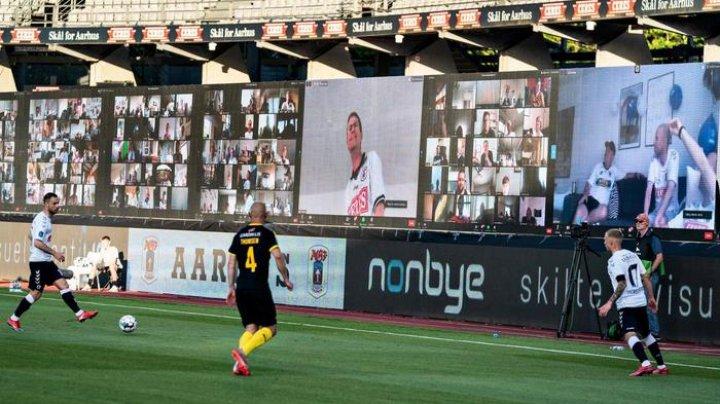 Болельщики датского клуба смотрели футбольный матч через конференцию в Zoom