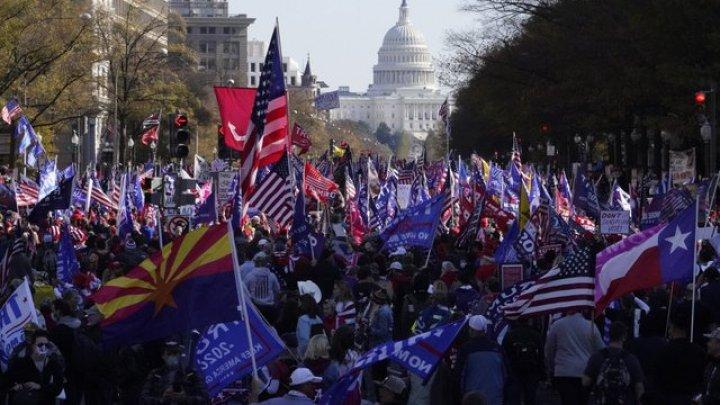 Сотни тысяч сторонников Дональда Трампа устроили марш в Вашингтоне