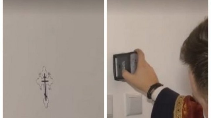 В Румынии священник, святивший дом, нанес крест на стену с помощью печати